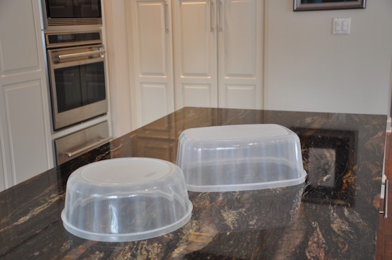 Use plastic containers to create different levels on your buffet