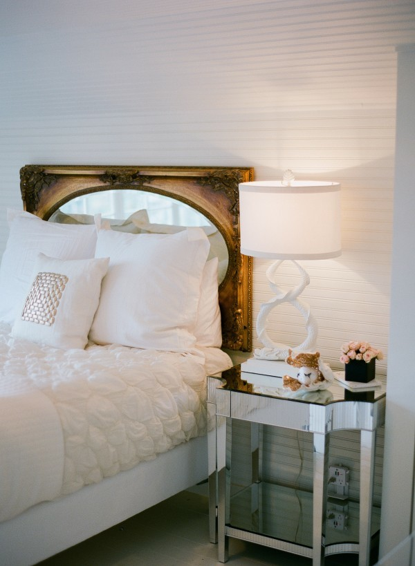 gold framed mirror as headboard