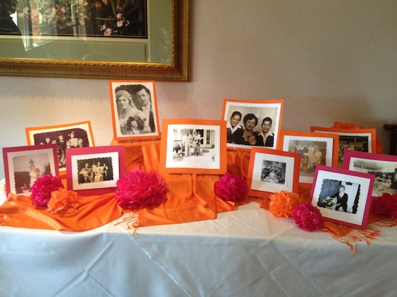 Place family pictures at a table near the entrance to the party.