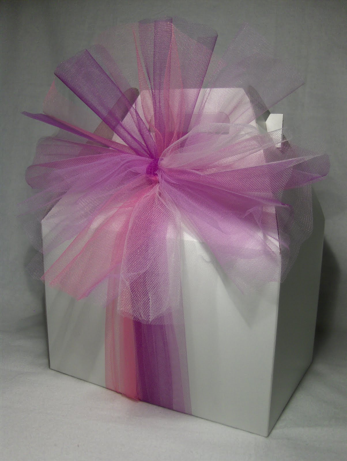 White box wrapped with pink tulle netting