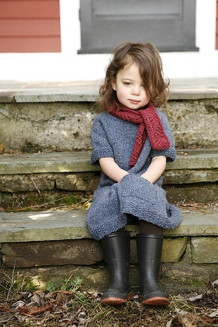 A collection of cute kids in Autumn scenes.  She's ready to jump in a puddle!
