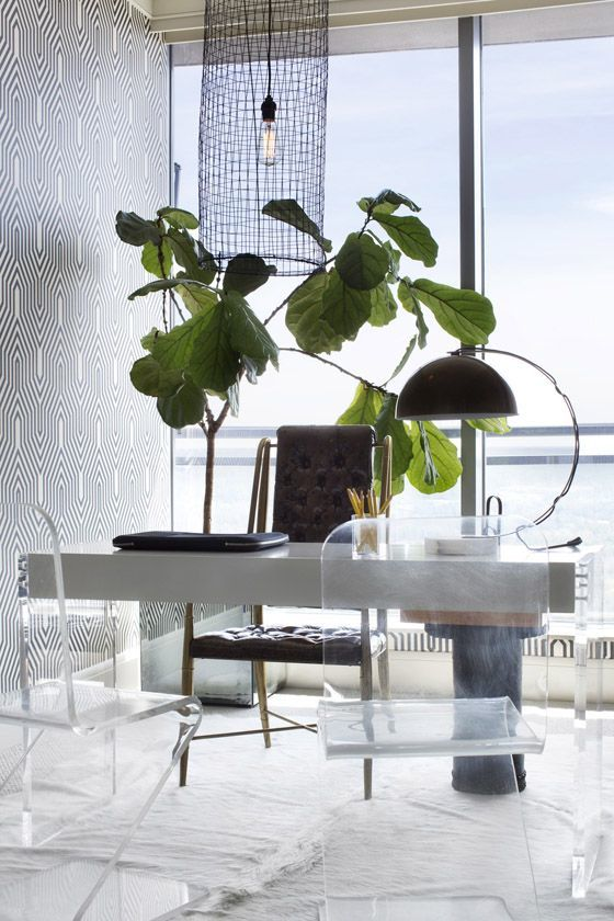 Office with a water view and lucite chairs