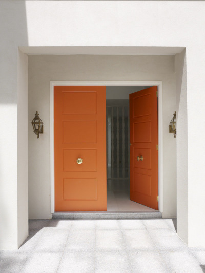 Orange Doors With Brass Door Knobs
