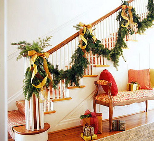 pretty christmas staircases this spacious foyer looks pretty with a full garland going up the - Christmas Decorations For Stair Rail