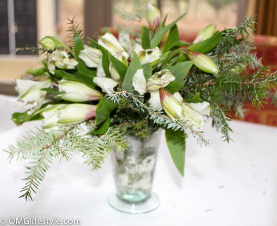 White Astromaria and evegreen center piece
