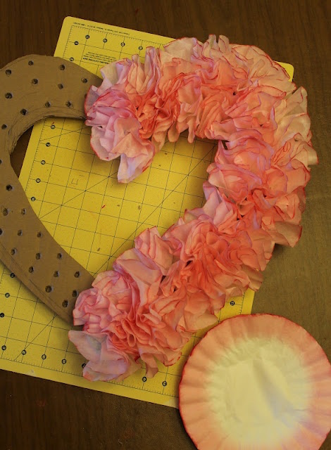 This wreath was made from coffee filters! | Read the post for more Valentine's Day Party Decorations