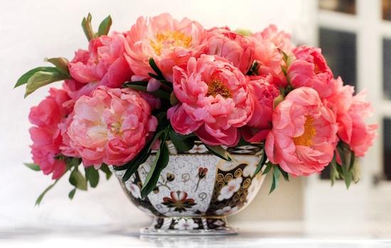 Arrange flowers in a bowl