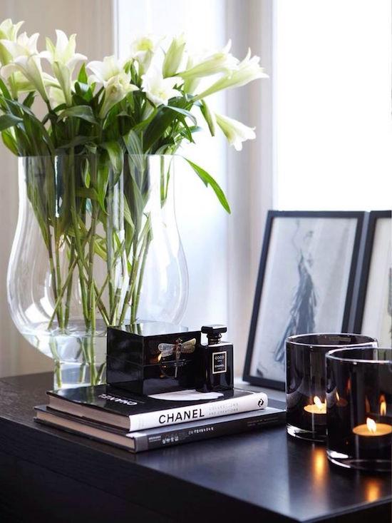 Arrange flowers in tall vases