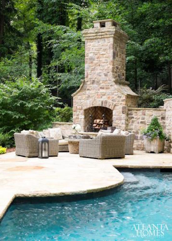 Inviting outdoor fireplaces omg lifestyle bog for Pool with fireplace