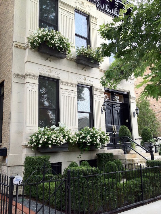 Brownstone with Black Window Boxes and White Flowers | OMG Lifestyle Blog