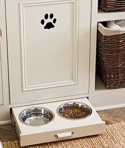 I love this idea of built-in feeding dishes for pets. When entertaining, you can hide the dishes in the cabinet. Visit the blog for other clever storage solutions behind closed doors.