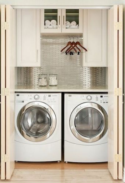 This Closet Laundry Room is ideal for a second floor laundry area or for a small condo. Visit the blog for additional storage solutions.