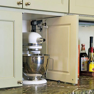Kitchen Appliance Storage Cabinet; Such a great idea for the heavier kitchen appliances | Visit the blog for other clever storage solutions behind closed doors