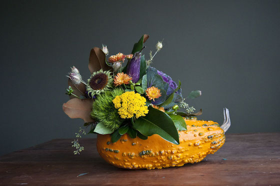 Stunning fall floral arrangements with pumpkins gourds