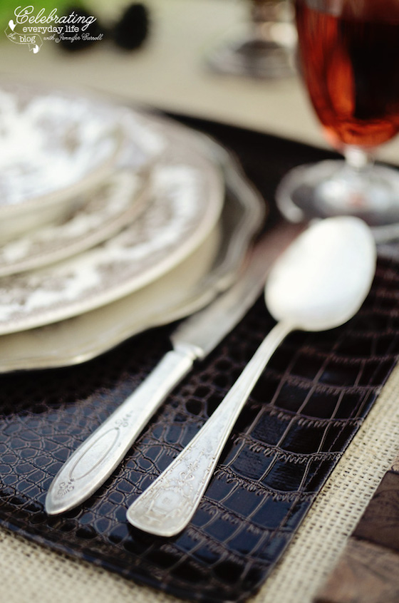 Tablescape Inspiration | Layered Placemats | I love how the burlap frames the leather placemat.