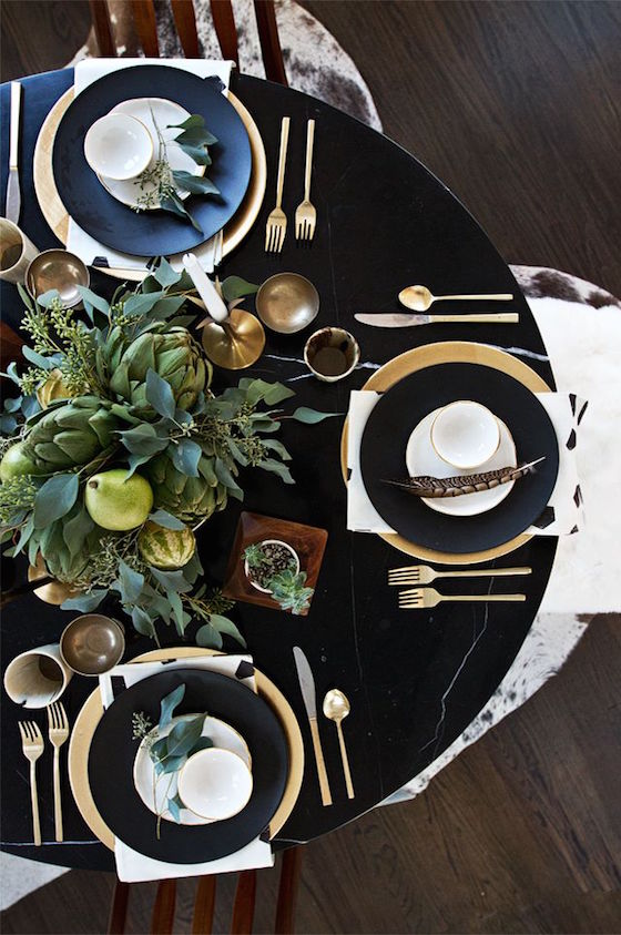 Tablescape Inspiration | Love this dark table with the gold chargers and silverware. So elegant!
