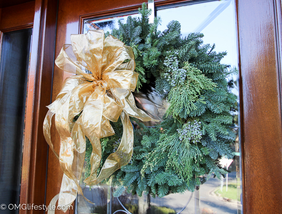 Merry and Bright Holiday Home Tour - OMG Lifestyle Blog - Fresh evergreen wreath with beautiful gold bow