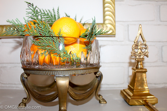 Merry and Bright Holiday Home Tour - OMG Lifestyle Blog - Oranges and evergreens add a festive touch to any glass bowl.