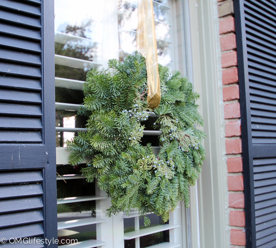 Merry and Bright Holiday Home Tour - OMG Lifestyle Blog - Christmas wreaths at each window, hung with gold ribbon