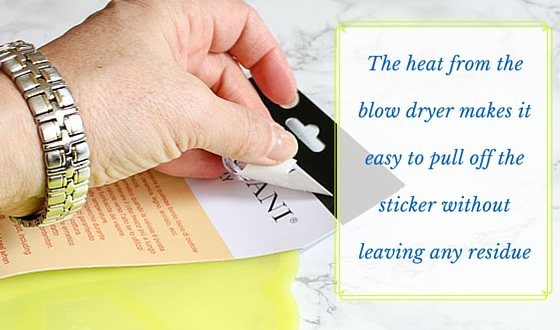 The heat from the blow dryer makes it easy to pull off the sticker without leaving any residue