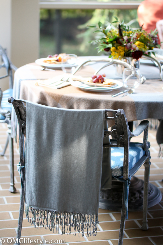 I like to place shawls on the chairs for the ladies when dining outdoors