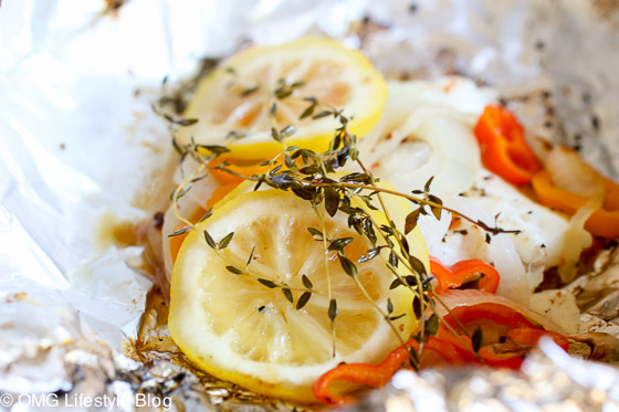 The lemons and peppers add color to the grilled halibut