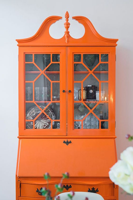 Paint Your Hutch A Bright Orange And Make It A Statement Piece