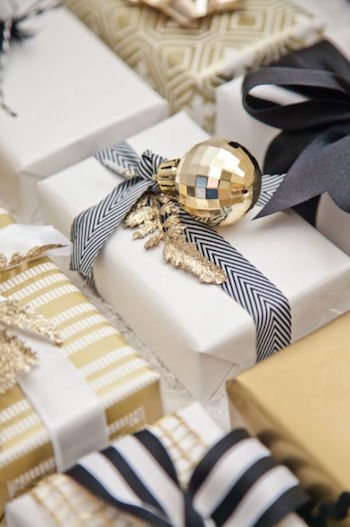 Add an ornament to plain gift wrap to make it holiday festive