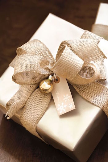 Burlap bow dressed up with gold ornament