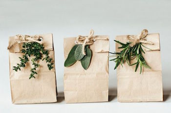 Fresh herbs and brown lunch bag gift bags