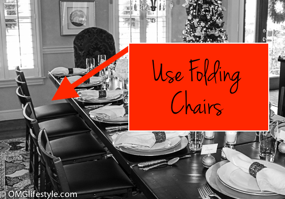 Use folding chairs instead of your dining room chairs to squeeze more people at the table