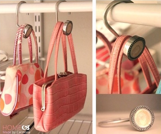 Use shower curtain hooks to hang purses in a closet