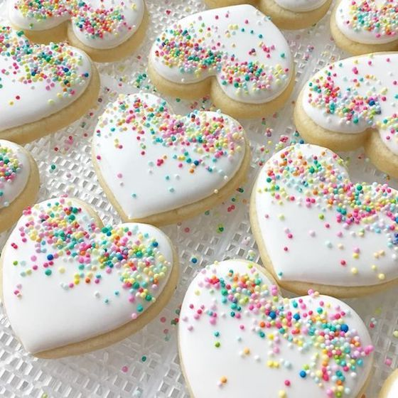 White Frosted Heart Shaped Cookies via Blue Sugar Cookie Co
